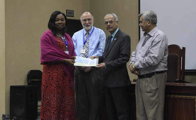 "Dr. Manzoor Soormro presenting certificate to a participant in the International Workshop on ""Genomics & Genome Editing"" May 24-27, 2016, while Dr. James Tebbe Rector FCC and Dr. Kausar A Malik are also present"